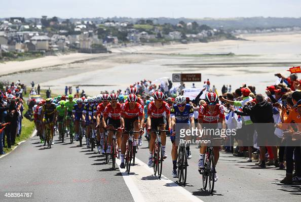 Thomas De Gendt of Belgium and LottoSoudal leads the peloton through the town of Granville during Stage One of Le Tour de France 2016 on July 2 2016...