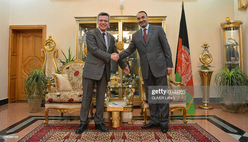 Thomas de Maiziere (L), German Minister of Defence and Mohammed Atta Noor (R) ,Governor of the Afghan province Balch, shake hands in the official governor's residence in Mazar-i-Sharif, Afghanistan on November 13, 2012. During his two-day surprise visit to Afghanistan De Maiziere visited the German troops and met with his Afghan counterpart for discussions on security issues.