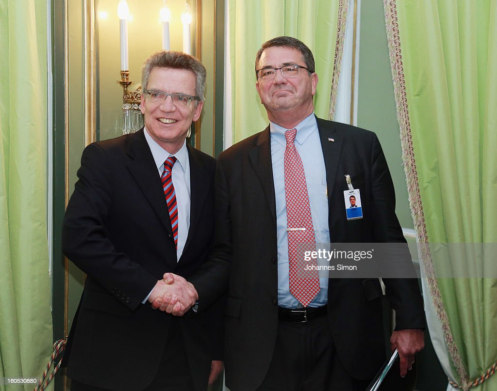 Thomas de Maiziere, German minister of defense and Ashton Carter, U.S. deputy secretary of defense shake hands ahead of a bilateral meeting at Hotel Bayerischer Hof on February 2, 2013 in Munich, Germany. The Munich Security Conference brings together senior figures from around the world to engage in an intensive debate on current and future security challenges and remains the most important independent forum for the exchange of views by international security policy decision-makers.