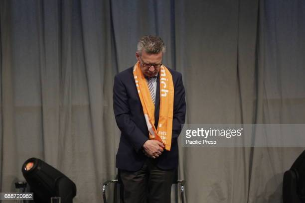Thomas de Maiziere stands in prayer at the stage The Grand Imam of alAzhar Ahmed elTayeb and Thomas de Maiziere the German Federal Minister of the...