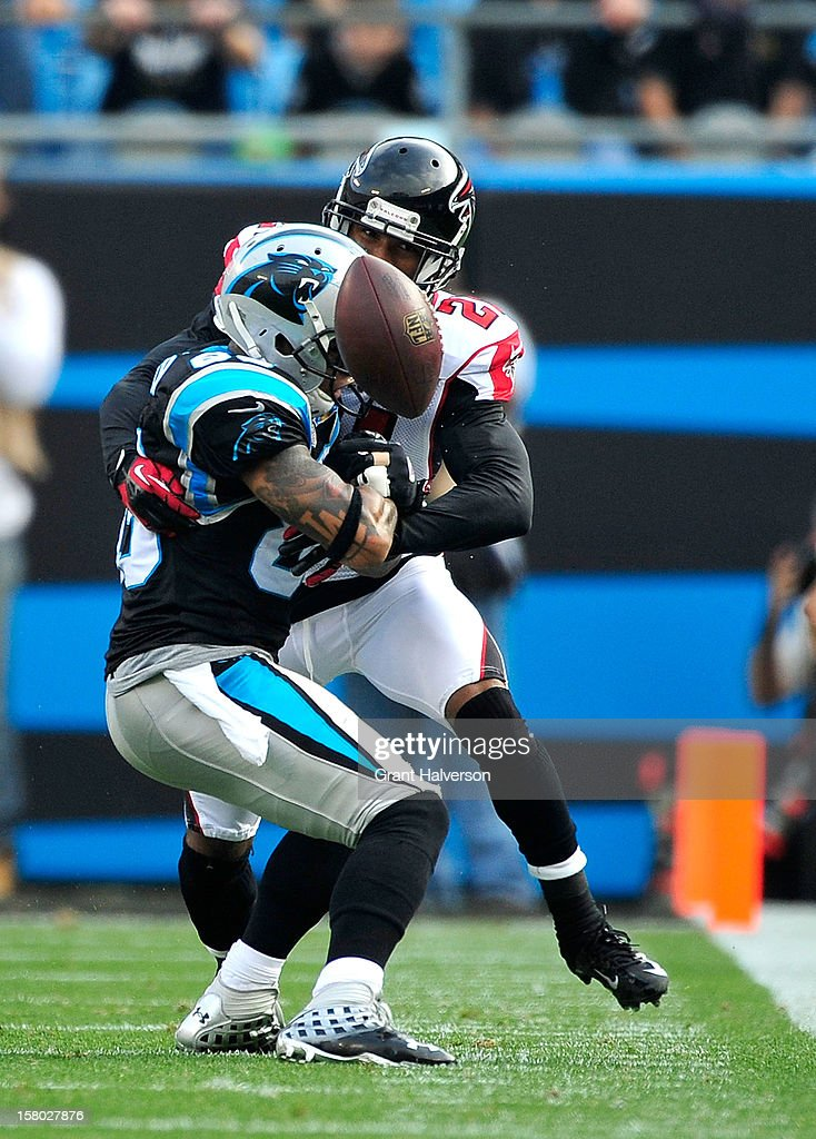 Thomas DeCoud #28 of the Atlanta Falcons breaks up a pass intended for Steve Smith #89 of the Carolina Panthers during play at Bank of America Stadium on December 9, 2012 in Charlotte, North Carolina.