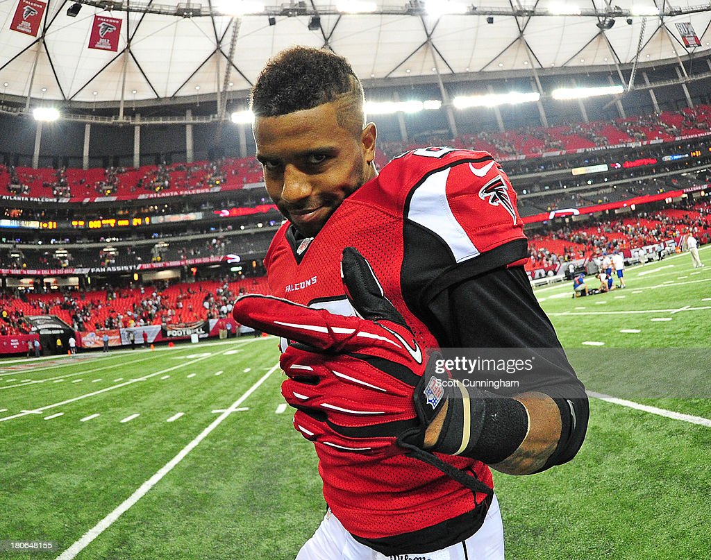 Thomas DeCoud #28 of the Atlanta Falcons celebrates after the game against the St. Louis Rams at the Georgia Dome on September 15, 2013 in Atlanta, Georgia.