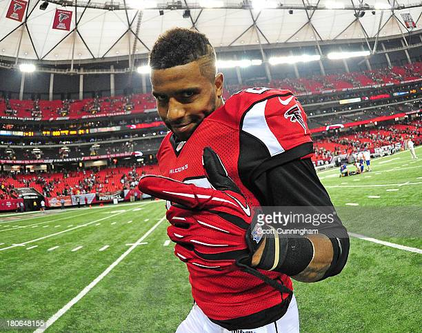Thomas DeCoud of the Atlanta Falcons celebrates after the game against the St Louis Rams at the Georgia Dome on September 15 2013 in Atlanta Georgia