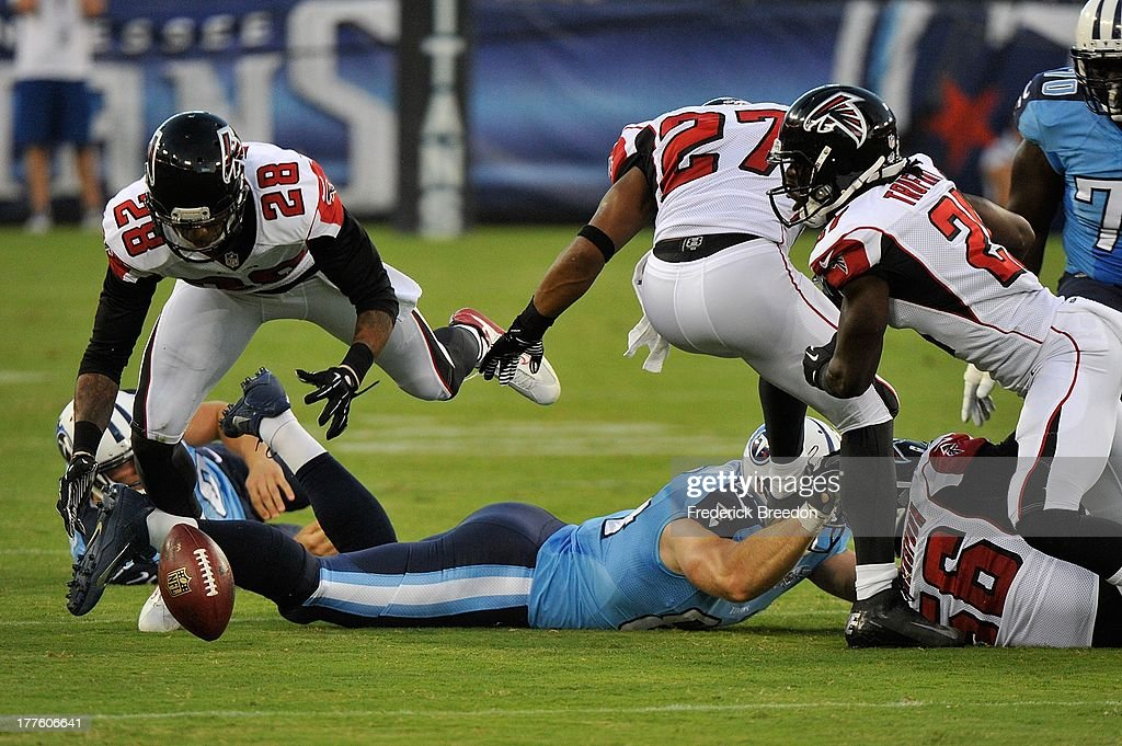 <a gi-track='captionPersonalityLinkClicked' href=/galleries/search?phrase=Thomas+DeCoud&family=editorial&specificpeople=4037323 ng-click='$event.stopPropagation()'>Thomas DeCoud</a> #28 of the Atlanta Falcons dives on a fumble against the the Tennessee Titans at LP Field on August 24, 2013 in Nashville, Tennessee.