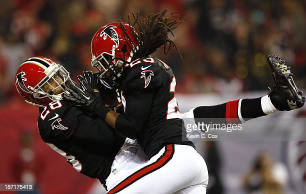 Thomas DeCoud of the Atlanta Falcons intercepts a pass in the end zone against the New Orleans Saints at Georgia Dome on November 29 2012 in Atlanta...