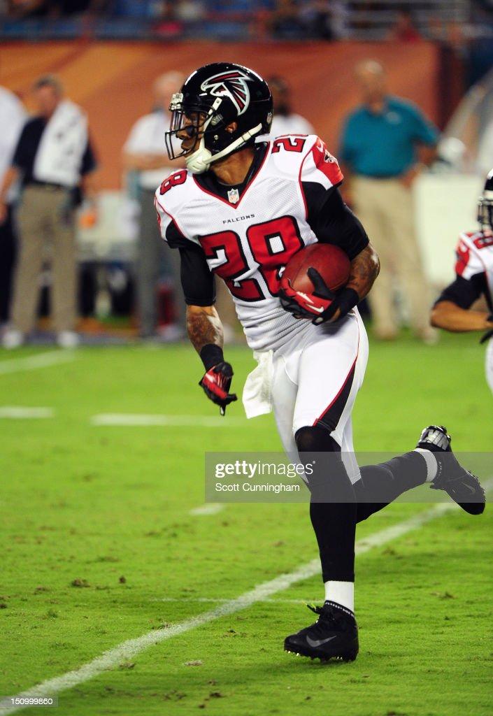 Thomas DeCoud #28 of the Atlanta Falcons runs with an interception against the Miami Dolphins at Sun Fife Stadium on August 24, 2012 in Miami Gardens, Florida.