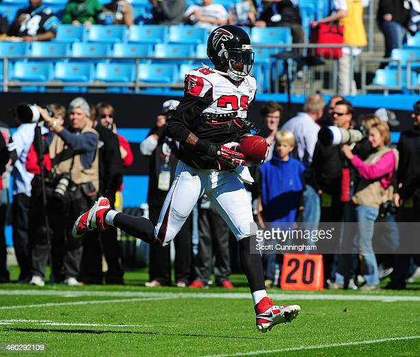 Thomas DeCoud of the Atlanta Falcons warms up before the game against the Carolina Panthers at Bank of America Stadium on November 3 2013 in...