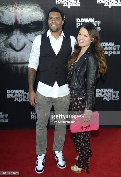 Thomas Decoud of the Carolina Panthers and guest pose at the premiere of 20th Century Fox's 'Dawn of the Planet of the Apes' at the Palace Of Fine...