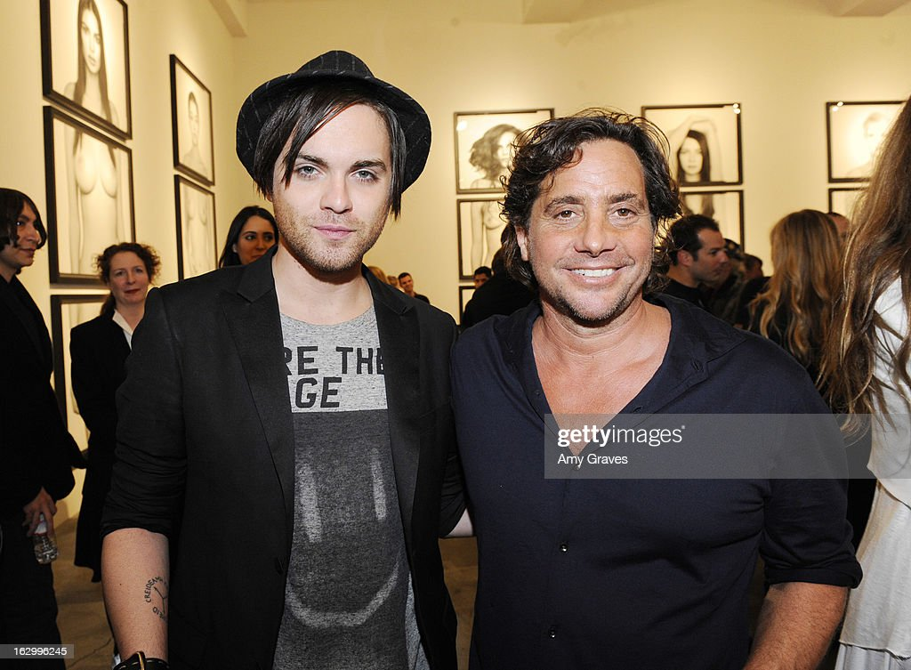 Thomas Dekker and Samuel Bayer attend the Samuel Bayer Ace Gallery Exhibit Opening, presented by Panavision at Ace Gallery on March 2, 2013 in Beverly Hills, California.