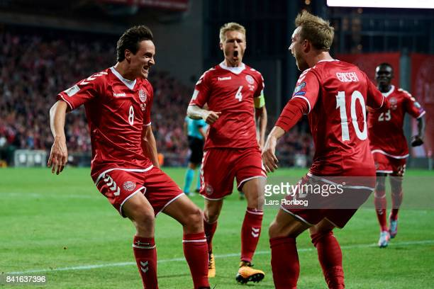 Thomas Delaney and Christian Eriksen of Denmark celebrate after scoring their first goal during the FIFA World Cup 2018 qualifier match between...