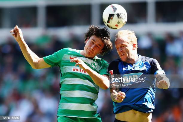 Thomas Delaney of Bremen and Kevin Vogt of Hoffenheim compete for the ball during the Bundesliga match between Werder Bremen and TSG 1899 Hoffenheim...