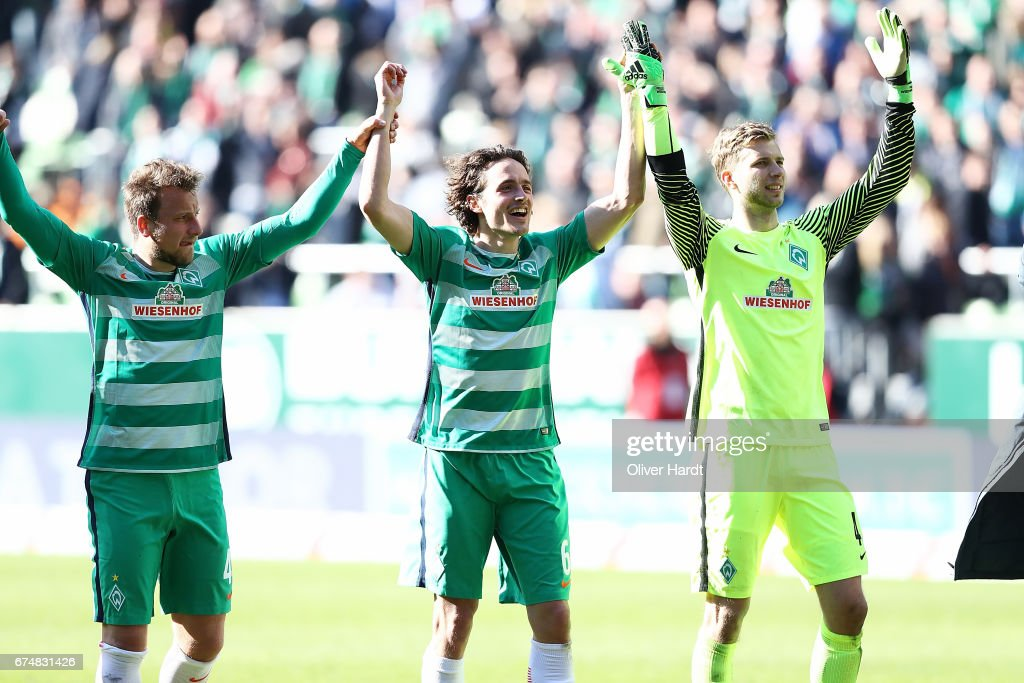 Thomas Delaney (C) of Bremen celebrate after the Bundesliga match between Werder Bremen and Hertha BSC at Weserstadion on April 29, 2017 in Bremen, Germany.