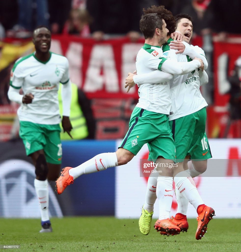 Thomas Delaney of Bremen celebrates his team's second goal with team mates during the Bundesliga match between 1. FSV Mainz 05 and Werder Bremen at Opel Arena on February 18, 2017 in Mainz, Germany.