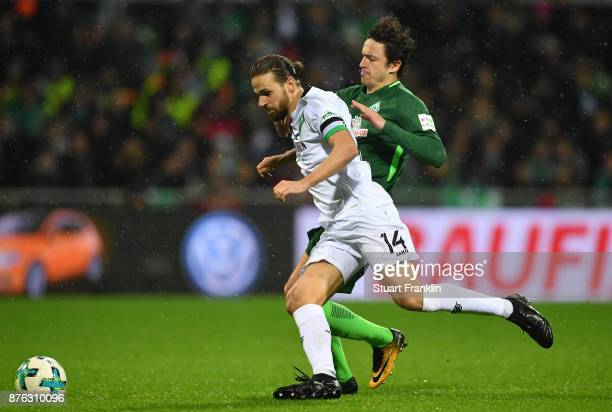 Thomas Delaney of Bremen is challenged by Martin Harnik of Hannover during the Bundesliga match between SV Werder Bremen and Hannover 96 at...