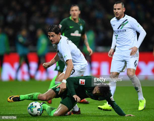 Thomas Delaney of Bremen is challenged by Miiko Albornoz of Hannover during the Bundesliga match between SV Werder Bremen and Hannover 96 at...