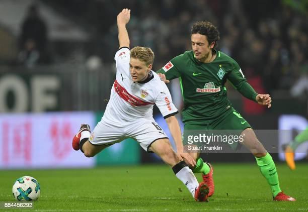 Thomas Delaney of Bremen is challenged by Santiago Ascacibar of Stuttgart during the Bundesliga match between SV Werder Bremen and VfB Stuttgart at...