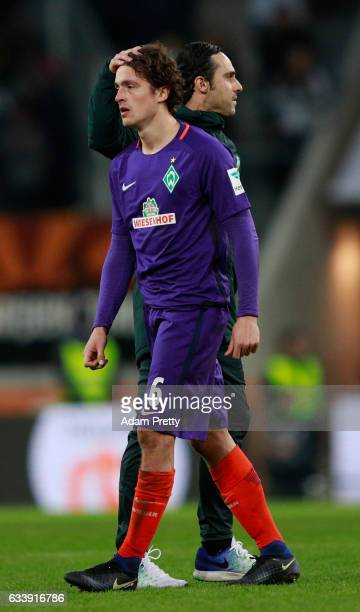Thomas Delaney of Bremen is consoled by Alexander Nouri head coach of Bremen after the Bundesliga match between FC Augsburg and Werder Bremen at WWK...