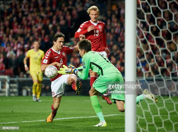 Thomas Delaney of Denmark and Kasper Dolberg of Denmark in action against Goalkeeper Ciprian Tatarusanu of Romania during during the FIFA World Cup...