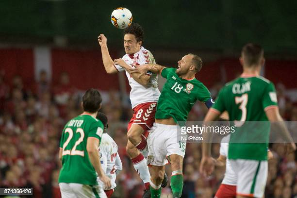 Thomas Delaney of Denmark jumps for the ball with David Meyler of Ireland during the FIFA World Cup 2018 PlayOff match between Republic of Ireland...