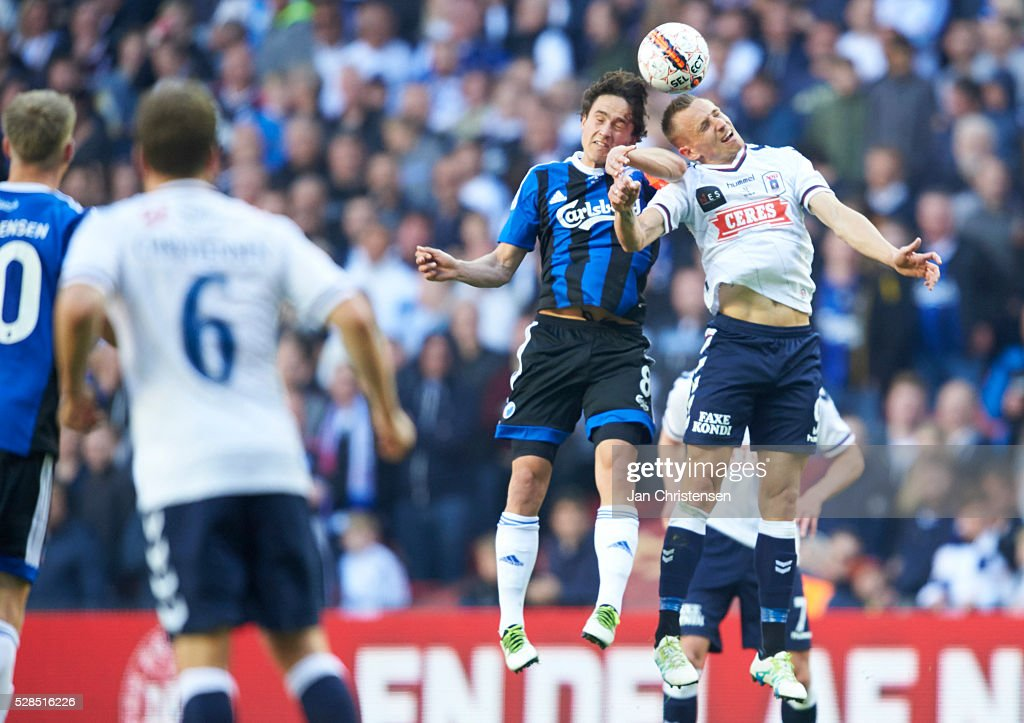 Thomas Delaney of FC Copenhagen and Danny Olsen of AGF Arhus heading the ball during the DBU Pokalen Cup Final match between AGF Arhus and FC Copenhagen at Telia Parken Stadium on May 05, 2016 in Copenhagen, Denmark.