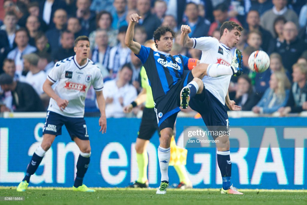 Thomas Delaney of FC Copenhagen and Stephan Petersen of AGF Arhus compete for the ball during the DBU Pokalen Cup Final match between AGF Arhus and FC Copenhagen at Telia Parken Stadium on May 05, 2016 in Copenhagen, Denmark.