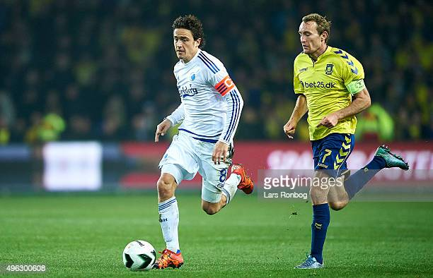 Thomas Delaney of FC Copenhagen is chased by Thomas Kahlenberg of Brondby IF during the Danish Alka Superliga match between Brondby IF and FC...