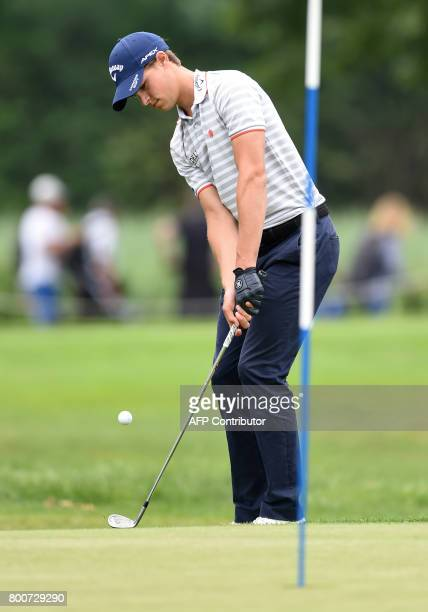 Thomas Detry from Belgium plays the ball during the final day of the BMW International Open golf tournament in Eichenried near Munich southern...