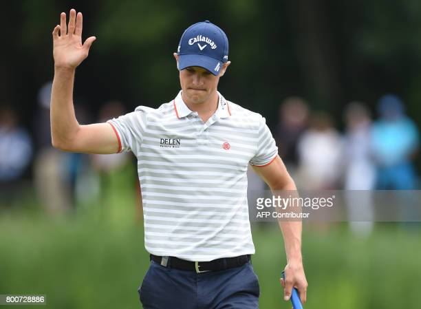 Thomas Detry from Belgium reacts after he played the ball during the final day of the BMW International Open golf tournament in Eichenried near...