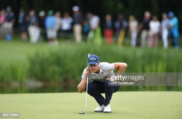 Thomas Detry from Belgium watches the ball during the final day of the BMW International Open golf tournament in Eichenried near Munich southern...