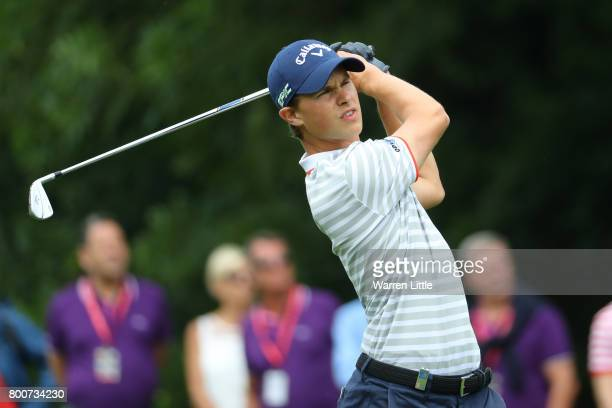 Thomas Detry of Belgium hits his second shot on the 10th hole during the final round of the BMW International Open at Golfclub Munchen Eichenried on...