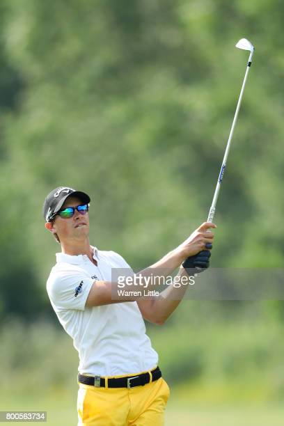 Thomas Detry of Belgium hits his second shot on the 15th hole during day three of the BMW International Open at Golfclub Munchen Eichenried on June...