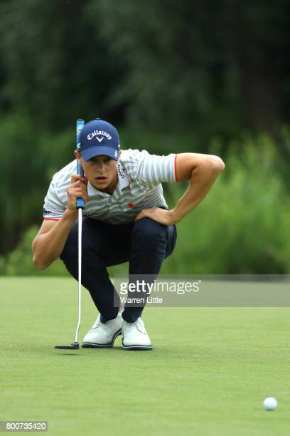 Thomas Detry of Belgium lines up a putt on the 11th green during the final round of the BMW International Open at Golfclub Munchen Eichenried on June...