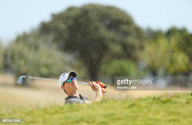 Thomas Detry of Belgium plays his second shot on the 1st hole during day four of the Portugal Masters at Dom Pedro Victoria Golf Club on September 24...