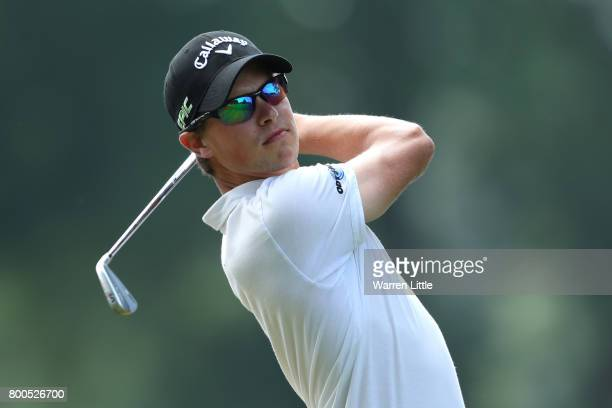 Thomas Detry of Belgium tees off on the 2nd hole during day three of the BMW International Open at Golfclub Munchen Eichenried on June 24 2017 in...