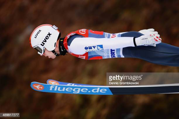 Thomas Diethart of Austria soars through the air during his first leg jump at Olympia Skistadion on January 1 2014 in GarmischPartenkirchen Germany