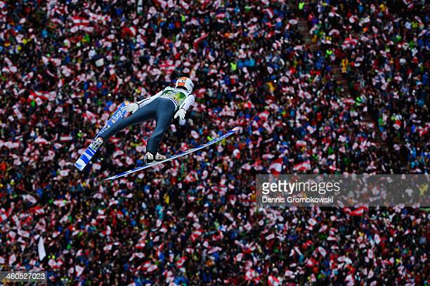 Thomas Diethart of Austria soars through the air during his first round jump on day 2 of the Four Hills Tournament event at Bergisel on January 4...