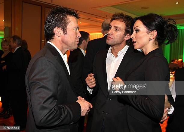 Thomas Doll of the DFV Legend and his wife Biljana have a chat with Lothar Matthaeus of the World Champion 1990 during the Players Night at the...