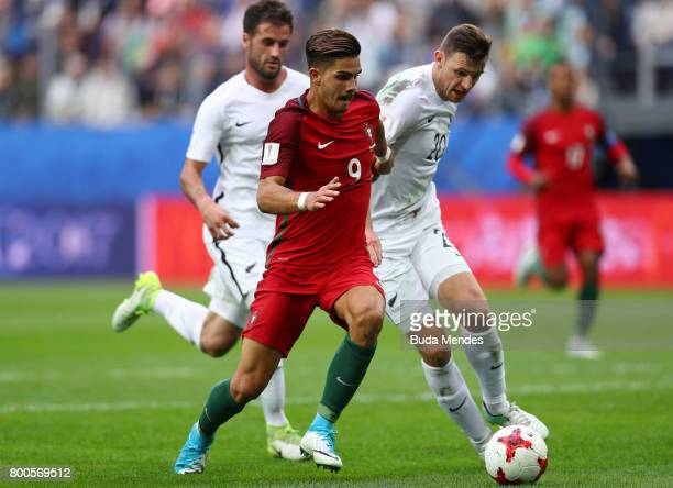 Thomas Doyle of New Zealand and Tommy Smith of New Zealand attempt to tackle Andre Silva of Portugal during the FIFA Confederations Cup Russia 2017...
