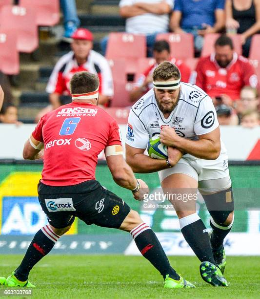 Thomas du Tuit of the Sharks going against Jaco Kriel of the Lions during the Super Rugby match between Emirates Lions and Cell C Sharks at Emirates...