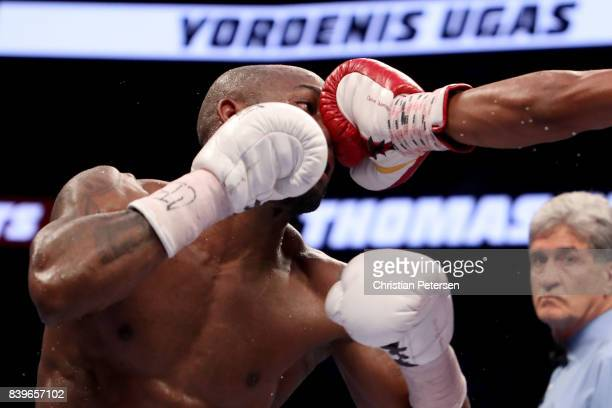 Thomas Dulorme throws a punch at Yordenis Ugas during their welterweight bout on August 26 2017 at TMobile Arena in Las Vegas Nevada