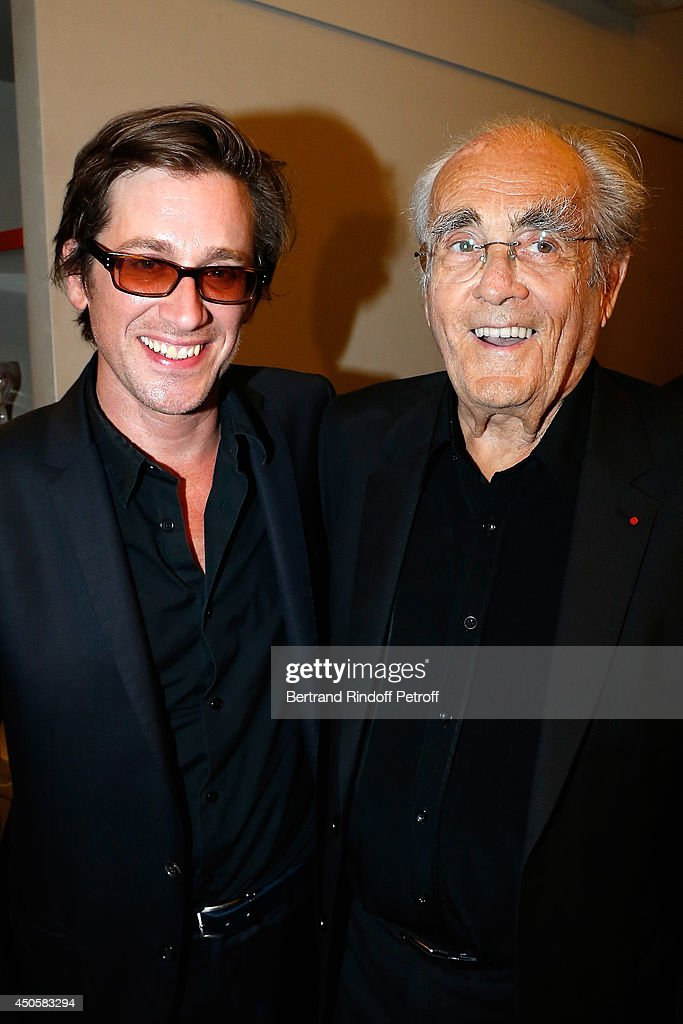 Thomas Dutronc and Michel Legrand pose after the one man show of Pierre Richard 'Le Vendredi 13 De Pierre Richard' at L'Olympia on June 13 2014 in...