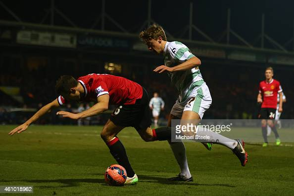 Thomas Eaves of Yeovil Town puts Jonny Evans of Manchester United under pressure during the FA Cup Third Round match between Yeovil Town and...