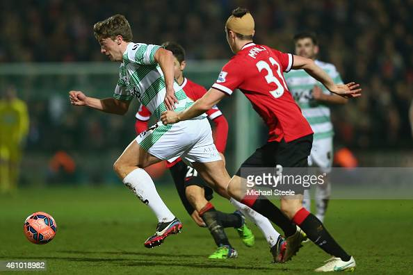 Thomas Eaves of Yeovil Town runs past Paddy McNair of Manchester United during the FA Cup Third Round match between Yeovil Town and Manchester United...
