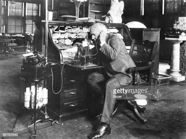 Thomas Edison American inventor dictating an order in his laboratory with his 'telescribe' on 1914