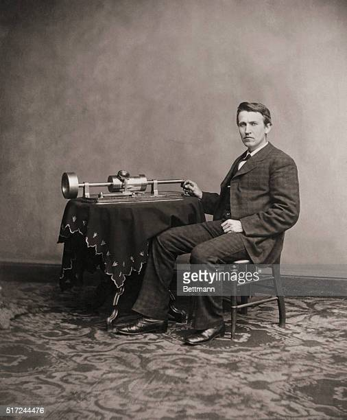 Thomas Edison and his phonograph in an undated photograph