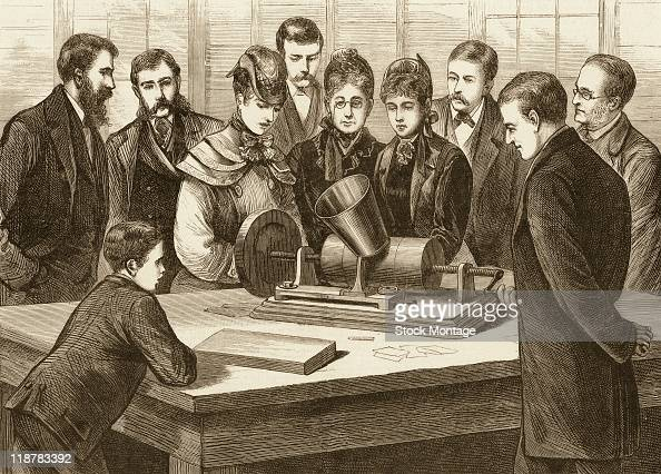 Thomas Edison shows one of his inventions a phonograph to people visiting his laboratory in Menlo Park New Jersey The picture was published in the...