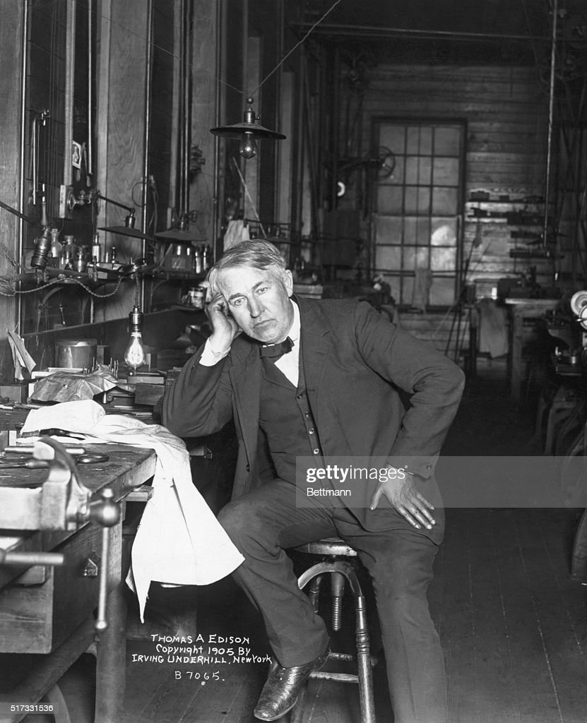 <a gi-track='captionPersonalityLinkClicked' href=/galleries/search?phrase=Thomas+Edison&family=editorial&specificpeople=69990 ng-click='$event.stopPropagation()'>Thomas Edison</a> sitting in workshop with quote: 'Genius is one percent inspiration and ninety nine percent perspiration.'