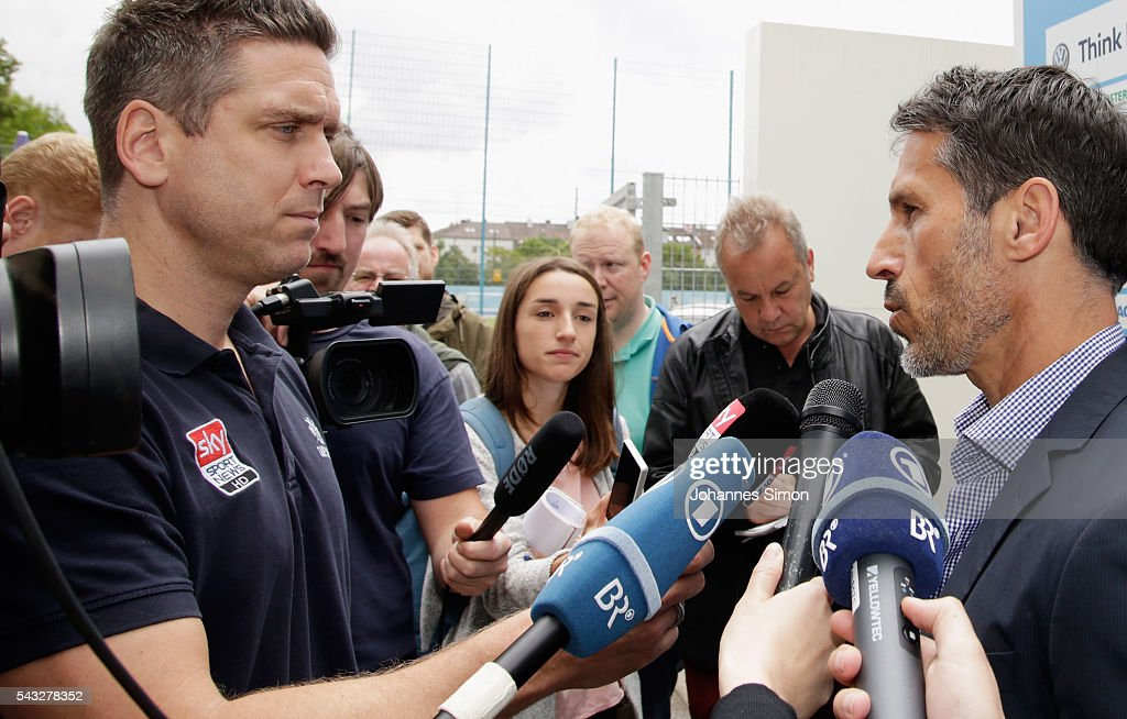 Thomas Eichin (R), new head of sport of TSV 1860 Muenchen gives interviews after a press conference at Gruenwalder Strasse training ground on June 27, 2016 in Munich, Germany.