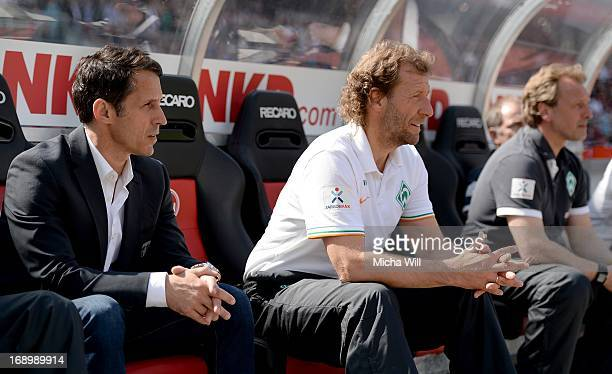 Thomas Eichin of Bremen caretaker manager Wolfgang Rolff of Bremen and caretaker manager Mathias Hoenerbach of Bremen look on during the Bundesliga...