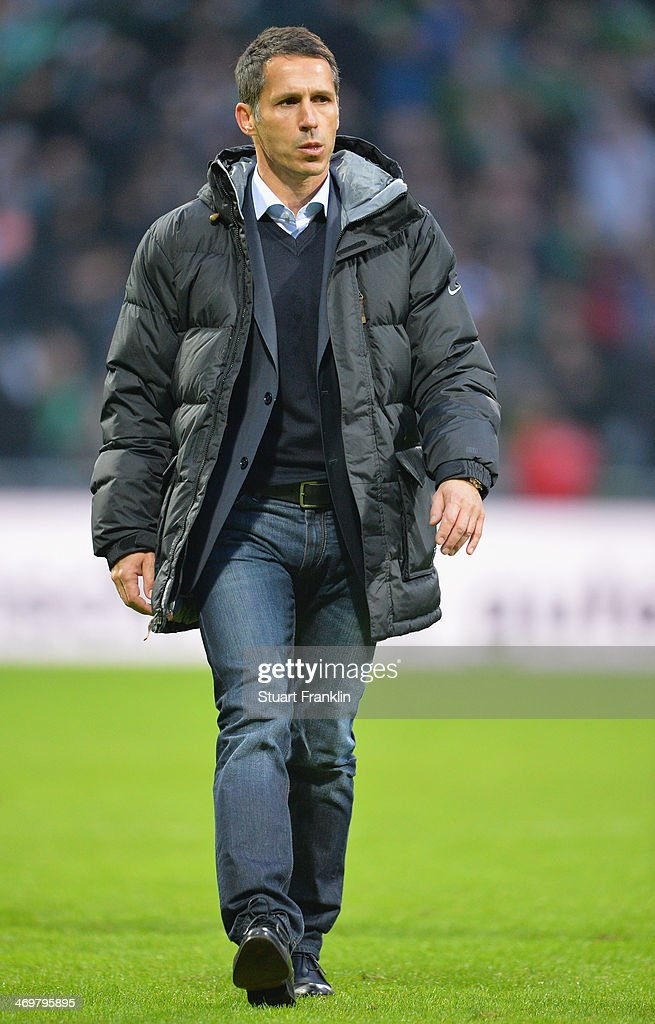 Thomas Eichin, sports director of Bremen looks on during the Bundesliga match between Werder Bremen and Borussia Moenchengladbach at Weserstadion on February 15, 2014 in Bremen, Germany.